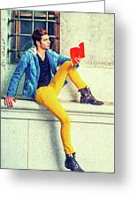 Young Man Reading Red Book, Sitting On Street Greeting Card