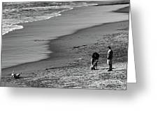 2 Dogs 2 Men Beach  Greeting Card