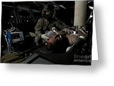 Flight Medic Looks After A Mock Patient Greeting Card