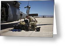 Pararescuemen Sorts Out His Gear Greeting Card