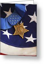 The Medal Of Honor Rests On A Flag Greeting Card