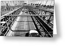 traffic vehicles driving over the worn tarmac on brooklyn bridge New York City USA Greeting Card