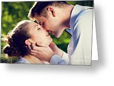 Young Romantic Couple Kissing With Love In Summer Park Greeting Card