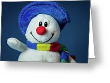 A Cute Little Soft Snowman With A Blue Hat And A Colorful Scarf Greeting Card