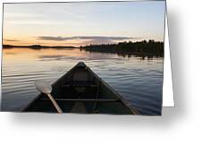 A Boat And Paddle On A Tranquil Lake Greeting Card
