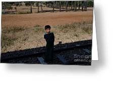 A Boy In Burma Looks Towards A Train From The Shadows Greeting Card