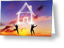 A Couple Jump And Make A House Symbol Of Light Greeting Card