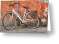 A Dejected Bicycle Waits Patiently On A Cobbled Street In Rome. Greeting Card