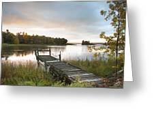 A Dock On A Lake At Sunrise Near Wawa Greeting Card by Susan Dykstra