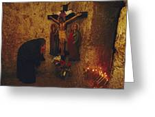 A Greek Pilgrim Prays In The Grotto Greeting Card by Annie Griffiths