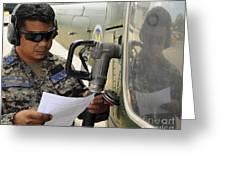A Honduran Crew Chief Consults Greeting Card