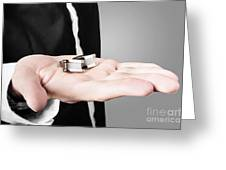 A Male Model Showcasing Cuff Links In His Hand Greeting Card