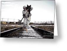 A Military Dog Handler Uses An Greeting Card by Stocktrek Images