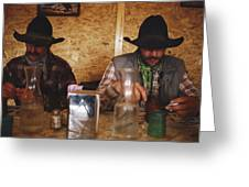 A Pair Of Cowboys Enjoy A Cup Of Coffee Greeting Card by Joel Sartore