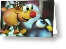 A Rudolph The Red Nosed Reindeer Ornament With A Penguin Greeting Card