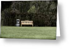 A Trash Can And Wooden Benches In A Small Grassy Area Greeting Card