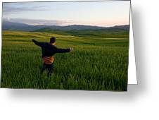 A Young Boy Runs Through A Field Greeting Card