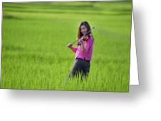 A Young Girl In A Folk Costume Plays A Vivaro In A Green Rice Fi Greeting Card