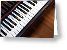 Antique Piano Keys From Above With Hardwood Floor Greeting Card