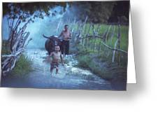 Asian Boy Playing Water With Dad And Buffalo Greeting Card