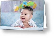 Asian Newborn Baby Smile In A Bed With Fish And Animal Mobile Greeting Card