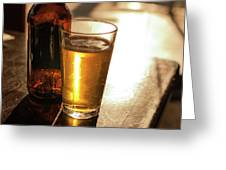 Backlit Glass Of Beer And Empty Bottle On Table Greeting Card