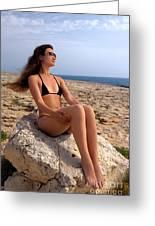 Beautiful Sexy Woman In Bikini Relaxing On A Rocky Seashore Greeting Card