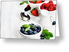 Berries In Bowls  On Wooden Background. Greeting Card