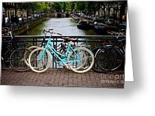 Bicycle Parked At The Bridge In Amsterdam. Netherlands. Europe Greeting Card