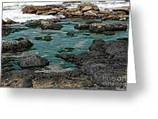 Black Rocks On Blue Water Greeting Card
