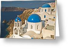 Blue Churches Of Santorini Greeting Card by Jim Chamberlain