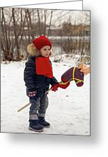 Boy On A Toy Horse Is Standing On The Street In Winter Greeting Card