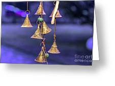 Brass Bells Hanging In The Illuminated Courtyard At Winter Night Greeting Card