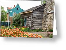 Cabin By The Tulips Greeting Card