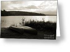 Canoe On A Shore Of A Lake At Dawn Greeting Card