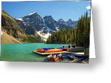 Canoes On A Jetty At  Moraine Lake In Banff National Park, Canada Greeting Card