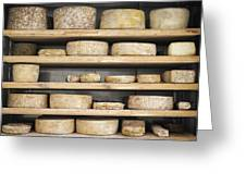 Cheese Wheels On Wooden Shelves In The Cheese Store Greeting Card
