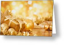 Christmas Scene With Gold Baubles And Gift On A Gold Background Greeting Card