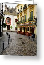 Cobblestone Argote De Molina Street With Cafe Ending At The Nort Greeting Card