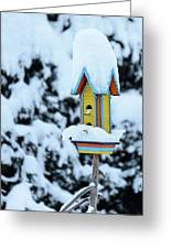 Colorful Wooden Birdhouse In The Snow Greeting Card