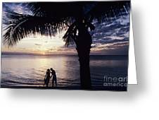 Couple Silhouetted On Beach Greeting Card