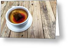 Cup Of Hot Tea On Wood Table Greeting Card