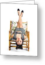 Cute Young Woman Sitting Upside Down On Chair Greeting Card
