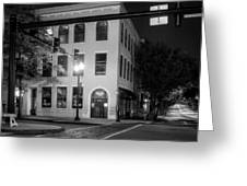 Distant Light On Front Street In Black And White Greeting Card