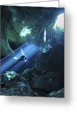 Diver Silhouetted In Sunrays Of Cenote Greeting Card