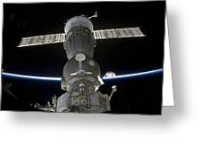 Earths Limb Intersects A Soyuz Greeting Card by Stocktrek Images