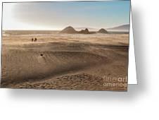 Family Walking On Sand Towards Ocean Greeting Card