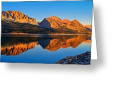 First Light Across Lake Sherburne Greeting Card by Greg Norrell