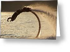 Flyboarder Doing Back Flip Over Backlit Waves Greeting Card