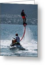 Flyboarder In Pink Shorts Above Jet Ski Greeting Card